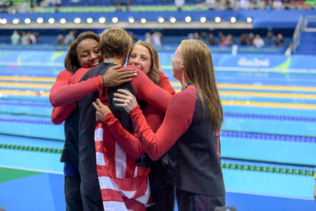 Rio de Janeiro, Brazil - august 13, 2016: Gold medalists Kathleen Baker, Lilly King, Dana Vollmer and Simone Manuel (USA) during Womens 4 × 100m medley relay of the Rio 2016 Olympics Games Editorial