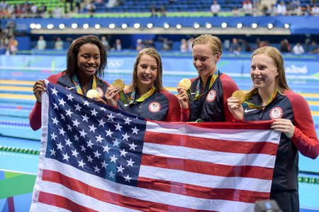 Rio, Brazil - august 13, 2016: Gold medalist Kathleen Baker, Lilly King, Dana Vollmer and Simone Manuel (USA) during Womens 4 × 100m medley relay of the Rio 2016 Olympics Games Editorial