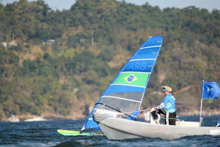 리오 데 자네이로, 브라질 - 2016 년 8 월 14 일 : 리카르도 산토스 (BRA), 리오 2016 올림픽 게임의 남자 rs-x medley 릴레이 중 에디토리얼
