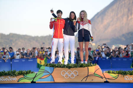 Rio de Janeiro, Brazil - august 14, 2016: Charline PICON (FRA) gold medal, Peina CHEN (CHN) silver and Stefaniya ELFUTINA (RUS) bronze during Podium ceremony Women's rs-x sailing of the Rio 2016 Olympics Games Stok Fotoğraf - 89388870