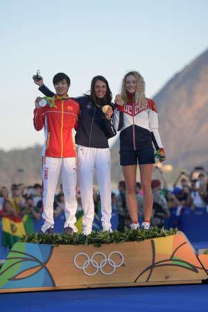 Rio de Janeiro, Brazil - august 14, 2016: Charline PICON (FRA) gold medal, Peina CHEN (CHN) silver and Stefaniya ELFUTINA (RUS) bronze during Podium ceremony Womens rs-x sailing of the Rio 2016 Olympics Games Editorial