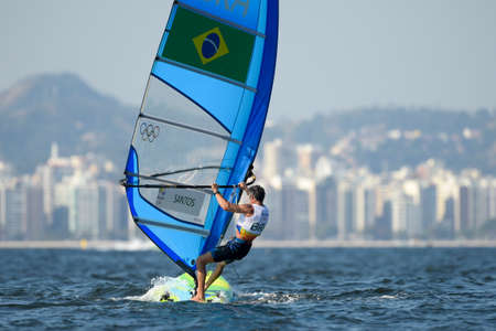 world championships: Rio de Janeiro, Brazil - august 14, 2016: Ricardo Santos (BRA) during Mens rs-x medley relay of the Rio 2016 Olympics Games Editorial