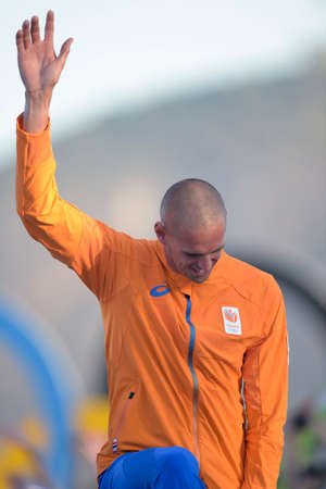 Rio de Janeiro, Brazil - august 14, 2016: Dorian van RIJSSELBERGHE (NED) gold medal during Podium ceremony Mens rs-x sailing of the Rio 2016 Olympics Games