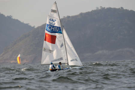 Rio de Janeiro, Brazil - august 15, 2016: WANG Wei (Helm) XU Zangjun (Crew) during mens 470 class sailing on the Rio 2016 Olympics Games Editorial