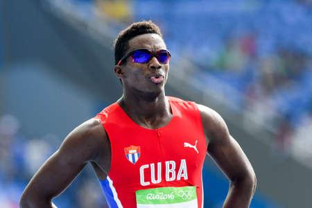 Rio de Janeiro, Brazil - august 18, 2016: Runner Leonel SUAREZ (CUB)2936 Mihail DUDAS (SRB) during Mens Decathon (110m Hurdles) in the Rio 2016 Olympics Games Editorial
