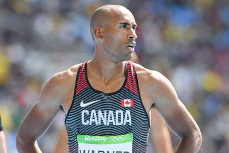 Rio de Janeiro, Brazil - august 18, 2016: Runner WARNER Damian (CAN) during Men´s Decathon (110m Hurdles) in the Rio 2016 Olympics Games Editorial
