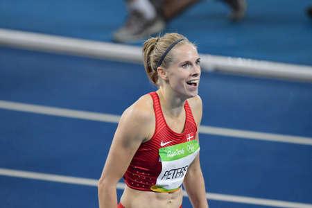 Rio de Janeiro, Brasile - 18 agosto 2016: Runner Sara Slott PETERSEN (DEN) durante i 400 metri ostacoli delle donne nelle Olimpiadi di Rio 2016 Archivio Fotografico - 89571654