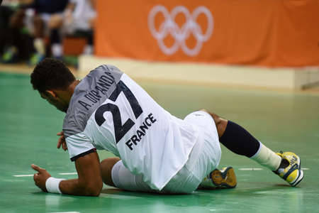 terrain de handball: Rio, Brazil - august 19, 2016: Adrien DIPANDA (FRA) during Handball game France (FRA) vs Germany (GER) in Future Arena in the Olympics Rio 2016