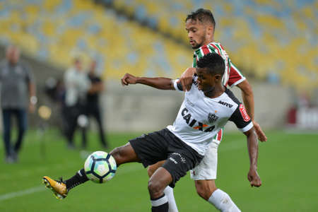Rio, Brazil - august 21, 2017: Cazares and Gustavo Scarpa player in match between Fluminense and  Atletico-MG by the Brazilian championship in Maracana Stadium Editorial