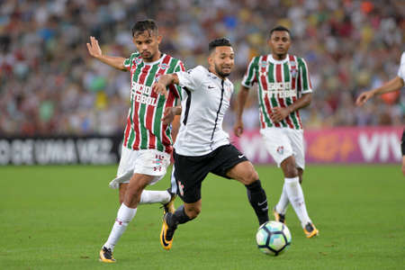 Rio, Brazil - july 23, 2017: Clayson and Gustavo Scarpa player in match between Fluminense and  Corinthians by the Brazilian championship in Maracana Stadium Editorial