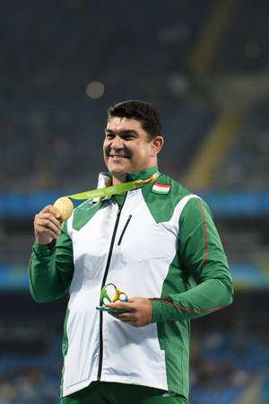 `Rio de Janeiro, Brazil - august 20, 2016: NAZAROV Dilshod (TJK) gold medal on the podium of the hammer throw during the Olympics Athletics Rio 2016 held at the Olympic Stadium (Engenhão)