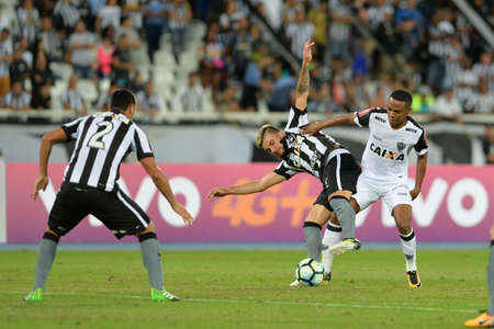 Rio, Brazil - jun 09, 2017: Victor Luis and Elias player in match between Botafogo and  Atletico-MG by the Brazilian championship in Nilton Santos Stadium Editorial