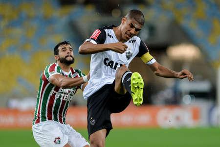 Rio, Brazil - august 21, 2017: Leonardo Silva and Henrique Dourado  player in match between Fluminense and  Atletico-MG by the Brazilian championship in Maracana Stadium