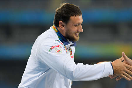 Rio de Janeiro, Brazil - august 20, 2016: TSIKHAN Ivan (BLR) silver medal on the podium of the hammer throw during the Olympics Athletics Rio 2016 held at the Olympic Stadium (Engenhão)