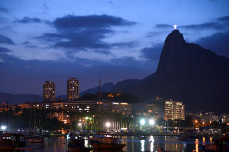 Rio de Janeiro, Brazil - dezembro 19, 2017: View of botafogo cove with Christ Redeemer in the background at dusk Editorial