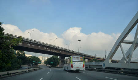 Rio de Janeiro, Brazil - may 25, 2018:  Urban passenger bus passing over the viaduct on day of little traffic in the city