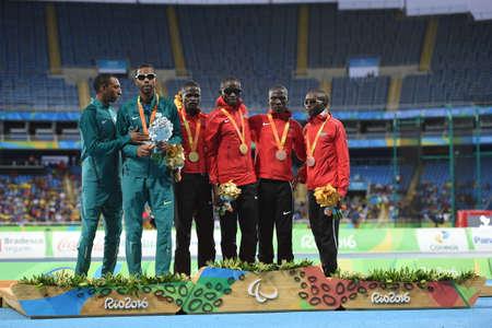 Rio, Brazil - september 08, 2016: KIMANI Samwel Mushai (KEN) (Gold); SANTOS Odair (BRA) (Silver) and BII Wilson (KEN) (Bronze) during men 100m - T11 Victory Ceremony in the Rio 2016 Paralympics Games.