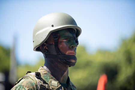 Rio de Janeiro, Brazil - september 07, 2018:  military civic parade celebrating the independence of Brazil. Soldier with painted face. 에디토리얼