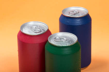 Colorful aluminium cans with a carbonated drink.