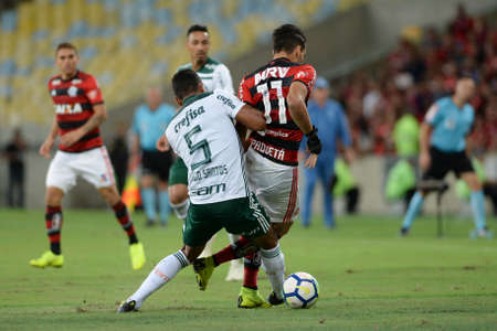 Rio, Brazil - october 27, 2018: Lucas Paqueta and Thiago Santos player in match between Flamengo and Palmeiras by the Brazilian Championship in Maracana Stadium Editorial