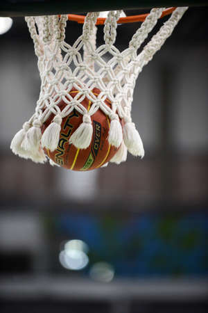 Rio de Janeiro, Brazil - november 01, 2018: basketball ball coming out of basketball net during match. Editorial