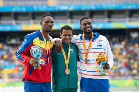 Rio, Brazil - september 09, 2016: MARTINS (BRA), PAIVA (VEN), BARBOSA (CPV) during mens 400m - T20, in the Rio 2016 Paralympics Victory Ceremony