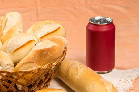 basket of french breads on a table and a cola can Banque d'images