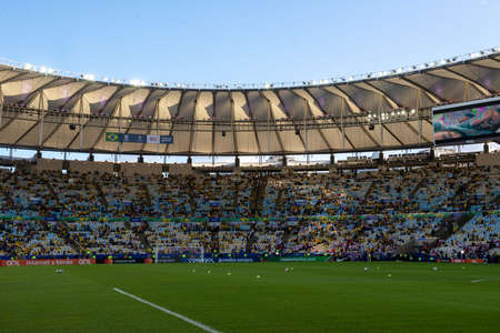 Rio, Brazil - July 7, 2019: Brazil soccer fans celebrating at the 2019 America Cup finals game between Brazil and Peru at Maracana Stadium.