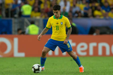 Rio, Brazil - July 7, 2019: Philippe Coutinho of Brazil kicks the ball during the 2019 America Cup finals game between Brazil and Peru at Maracana Stadium.