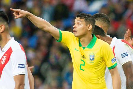 Rio, Brazil - July 7, 2019: Thiago Silva of Brazil kicks the ball during the 2019 America Cup finals game between Brazil and Peru at Maracana Stadium.