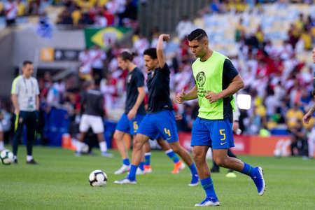 Rio, Brazil - July 7, 2019: Casemiro of Brazil entering the field before the CONMEBOL 2019 America Cup finals at Maracana Stadium.