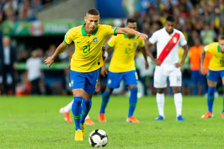 Rio, Brazil - July 7, 2019: Richarlison of Brazil kicks the ball during the 2019 America Cup finals game between Brazil and Peru at Maracana Stadium.
