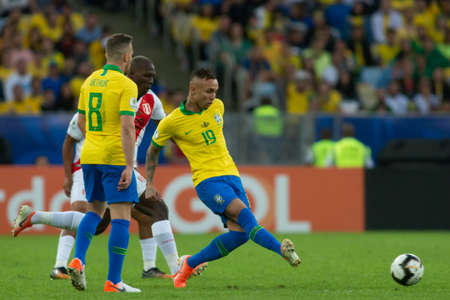 Rio, Brazil - July 7, 2019: Everton (Cebolinha) of Brazil kicks the ball during the 2019 America Cup finals game between Brazil and Peru at Maracana Stadium.