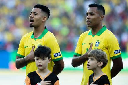 Rio, Brazil - July 7, 2019: Alex Sandro Silva e Gabriel Jesus during Brazil National Anthem at the 2019 America Cup finals game between Brazil and Peru at Maracana Stadium.