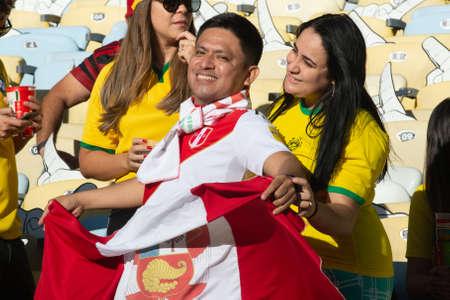Rio, Brazil - July 7, 2019: Peru soccer fans celebrating at the 2019 America Cup finals game between Brazil and Peru at Maracana Stadium.