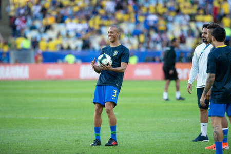 Rio, Brazil - July 7, 2019: Joao Miranda of Brazil entering the field before the CONMEBOL 2019 America Cup finals at Maracana Stadium.