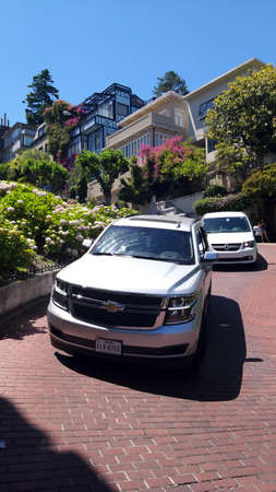 San Francisco, USA - june 11, 2019: cars descending the Lombard street, important tourist point of the city. The place is scenery of many movies