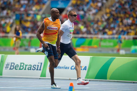 Rio, Brazil - september 10, 2016: ADOLPHE Timothee (FRA) Guide JOHN Jeffrey (FRA) during Men 100m - T11 Round 1 Heat 2, in the Rio 2016 Paralympics Games. 에디토리얼