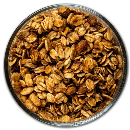 granola, grain, bulk in a bowl isolated on white background, top view