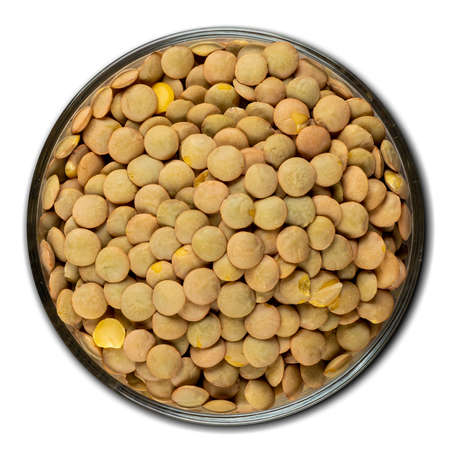 Lentil, grain, bulk in a bowl isolated on white background, top view