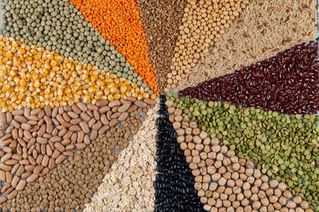 Big collection of different cereals and edible seeds. Grain angular pattern with top view Editöryel