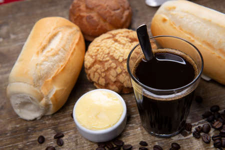 Brazilian traditional black coffee with french bread