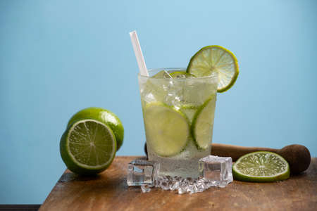 Glass of caipirinha, typical brazilian drink on a wooden board Imagens