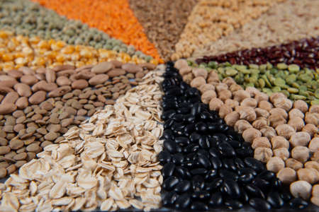 Big collection of different cereals and edible seeds. Grain angular pattern with top view Imagens