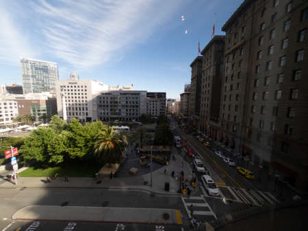 San Francisco, USA - june circa, 2019: downtown street corner near Union Square viewed from above with cars and building facades