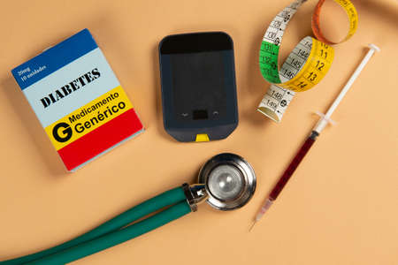 Fake medicine box with the name of the disease Diabetes and a glucometer Zdjęcie Seryjne