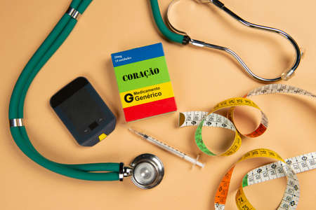 Fake medicine box with the name of the disease Coracao and a glucometer