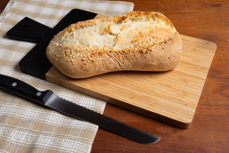 homemade french type bread with sesame on rustic wooden background Stok Fotoğraf - 147580232