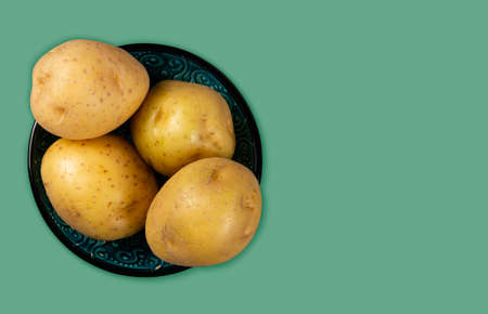 pot of raw potato seen from above. text space