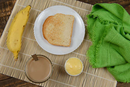 typical brazilian small breakfast, with cup of coffee with milk and bread. Top view